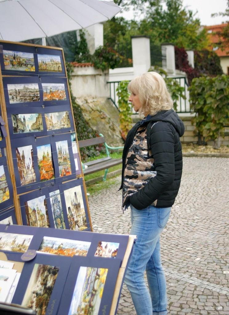 Praga z Muchą w tle